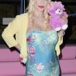 Ilona Staller Cicciolina per una notte coroncina di fiori in testa e orsacchiotto rosa 06