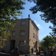 """Bologna: immigrati sul tetto contro sgombero. Commenti su Fb: """"Buttatevi"""" FOTO 03"""