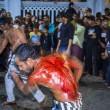 Ashura, il rito degli sciiti musulmani: uomini frustati e tagliati con catene e coltelli14