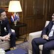 Il capo dell'Eurogruppo Jeroen Dijsselbloem con Tsipras ad Atene (LaPresse)