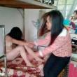 Cina, bulle sedicenni picchiano, spogliano una compagna e postano FOTO online 2