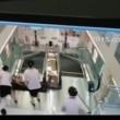 VIDEO YouTube - Stritolata da scala mobile: prima di morire mette in salvo il figlio 05