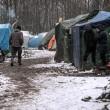 Profughi nel fango, combattono neve e gelo tra le baracche14