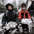 Profughi nel fango, combattono neve e gelo tra le baracche9