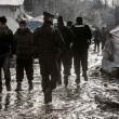 Profughi nel fango, combattono neve e gelo tra le baracche17