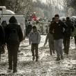 Profughi nel fango, combattono neve e gelo tra le baracche16