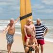 Marine in posa con tavola da surf stessa FOTO 50 anni dopo 2