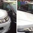Jaguar blocca parcheggio: suv la sposta colpendola