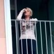 (nella foto mentre piange durante i giorni della crisi cardiaca di Berlusconi)